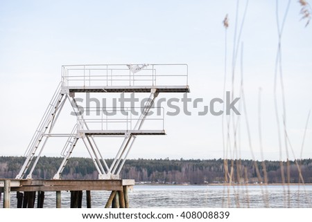 Empty diving tower on a dock. - stock photo