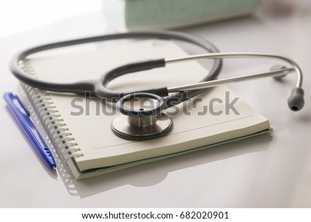 empty doctor workplace with a stethoscope and pen