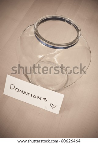 Empty Donation Jar Concept Image of Greed - stock photo