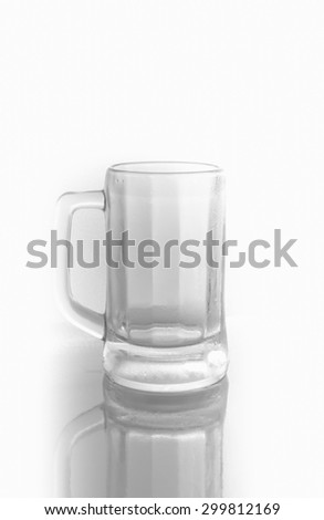 Empty drinking glass cup on white background. Black and white style.select focus.