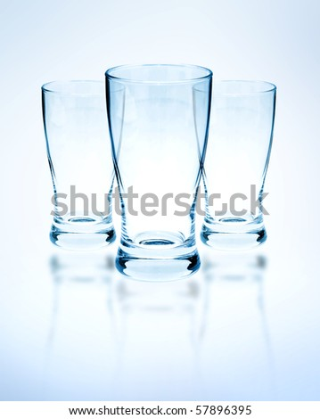 Empty drinking glasses on a white background - stock photo