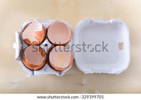 Empty egg shelves on egg packaging  - stock photo