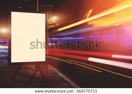 Empty electronic billboard with copy space for your text message or promotional content, public information board in the big city at night, advertising mock up with movement of cars on the background - stock photo