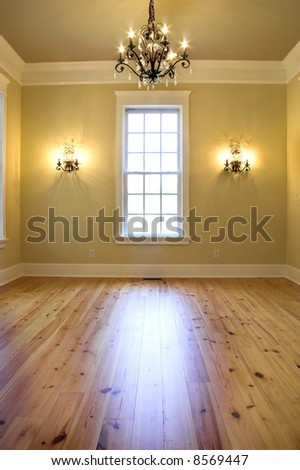 empty elegant diningroom or bedroom with chandelier - stock photo
