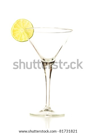 Empty elegant glass and lemon on white background