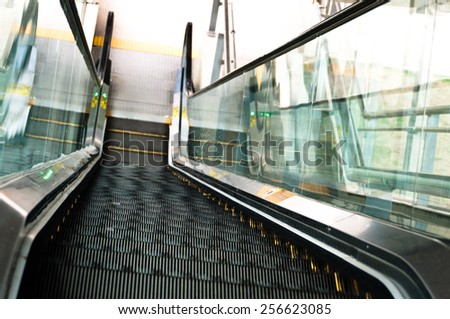 Empty Escalator Perspective From Up to Down - stock photo