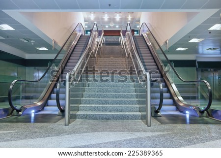 Empty escalator stairs in the airport - stock photo