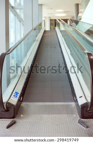 Empty escalator stairs in the mall. - stock photo
