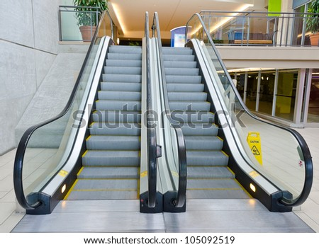 Empty escalator stairs in the Terminal ( Mall ) - stock photo