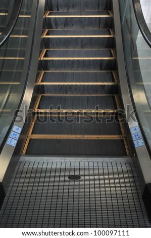 Empty escalator stairs logo warning - stock photo