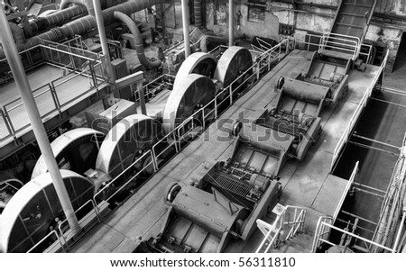 Empty factory interior of abandonment in black and white. - stock photo