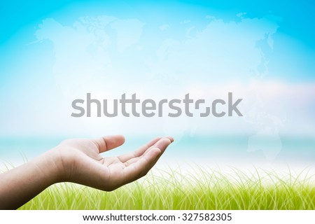 Empty female open hand holding. Abstract blurred background of ocean beach. Open palm hand gesture of female hand. Ocean beach with green grass. Designed to help the world reach. Map world - stock photo