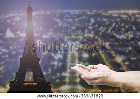 Empty female open human hands prayer with abstract Background top view of Paris in lights and bokeh. Concept for pray for Paris, Thanksgiving, Christmas, Forgiveness euro 2016 France.  - stock photo