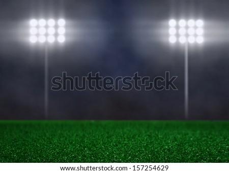 Empty Field with Spotlights and Smoke - stock photo