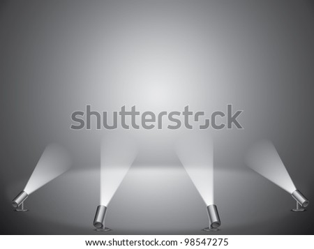 empty field with spotlights on gray background