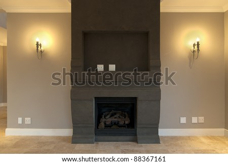 Empty fireplace and lounge inside a modern house - stock photo