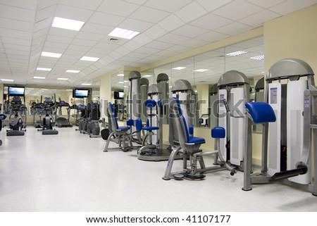 Empty fitness club with treadmills - stock photo