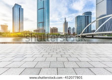 empty floor and city skyline under blue sky,tianjin china - stock photo