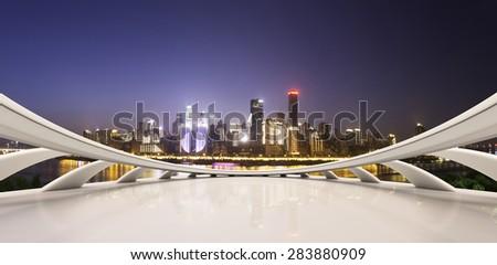 Empty floor and illuminated skyline - stock photo