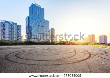 Empty floor and modern building with sunbeam - stock photo