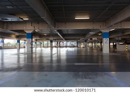 Empty floor of multistory parking lot - stock photo