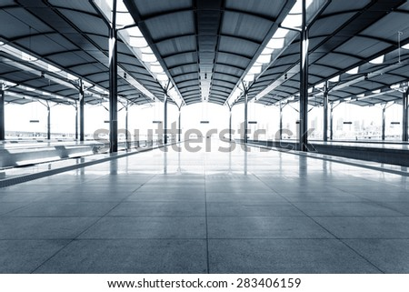 Empty floor of train station platform