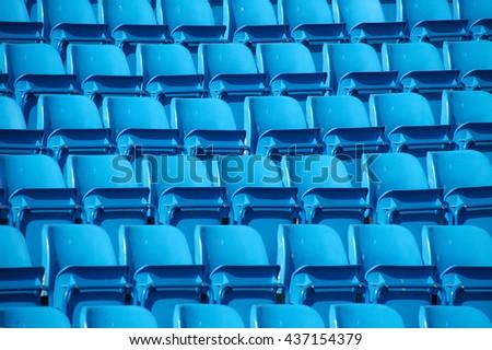 Empty folding blue stadium seating - stock photo
