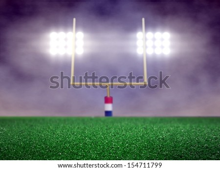 Empty Football Field and Spotlight with Smoke - stock photo