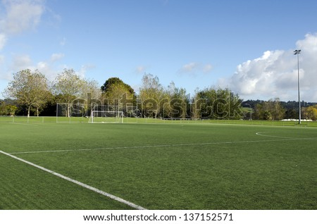 Empty football field in a city park. - stock photo