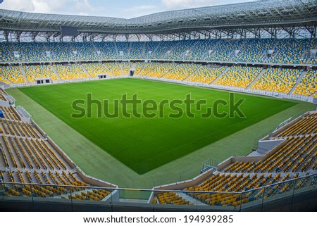 empty football stadium in the afternoon - stock photo