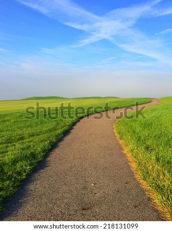 Empty footpath in the morning mist on the golf course  - stock photo
