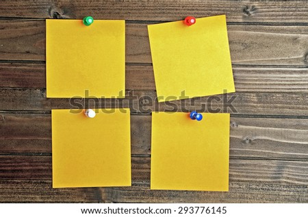 Empty four notes on wooden table