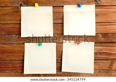 Empty four notes on wooden wall - stock photo