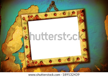 Empty frame hanging on a broken wall, urban style - stock photo