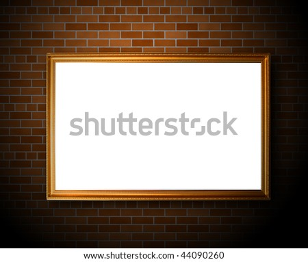 Empty frame hanging on the brick wall - stock photo