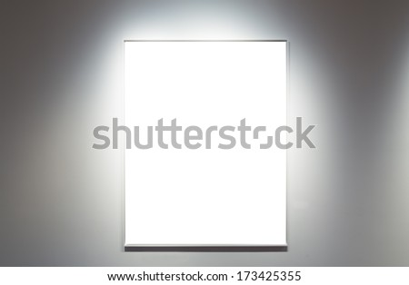 Empty frame in a gallery - stock photo