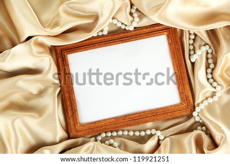 empty frame on beautiful silk - stock photo