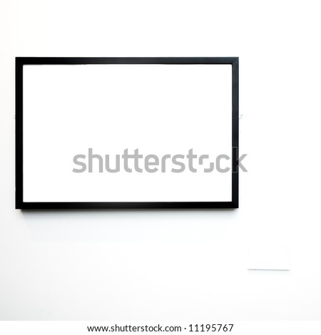 empty frame on white wall in museum - stock photo