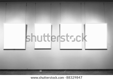 empty frames in a room against a white wall - stock photo