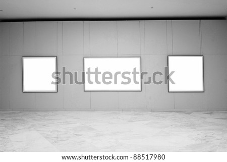 empty frames in a room against a white wall