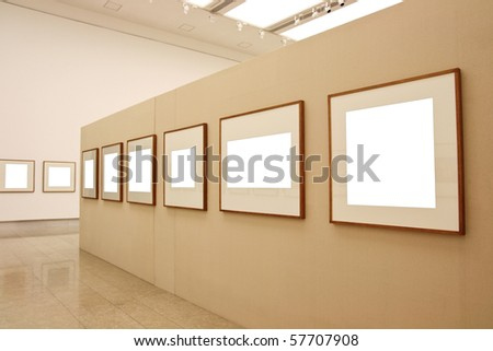 empty frames in a room against exhibition wall - stock photo