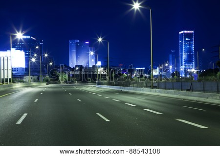 Empty freeway at night - stock photo