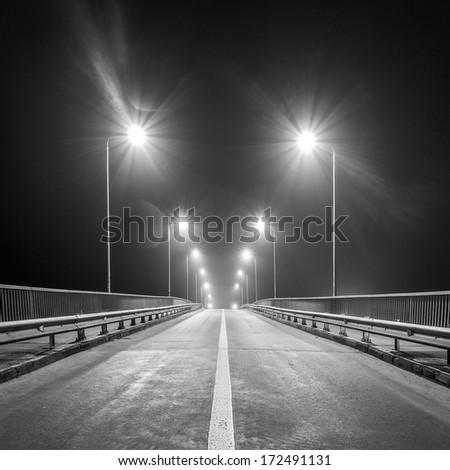 Empty freeway at night. Black and white. - stock photo