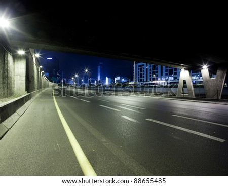 Empty freeway at night - This image was taken from three different shots - stock photo