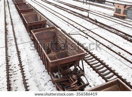 Empty freight wagons on the railroad in winter - stock photo
