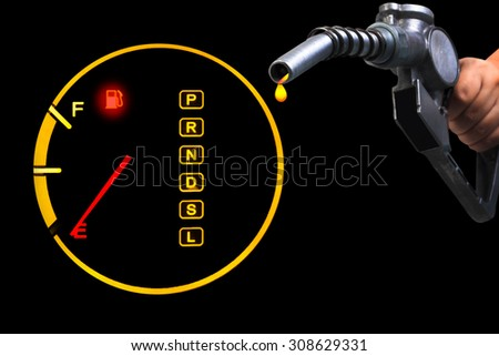 Empty fuel guage with hand holding fuel nozzle pumping a fuel - stock photo