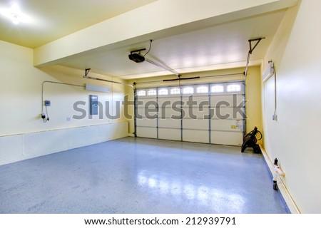 Empty garage interior in new house - stock photo