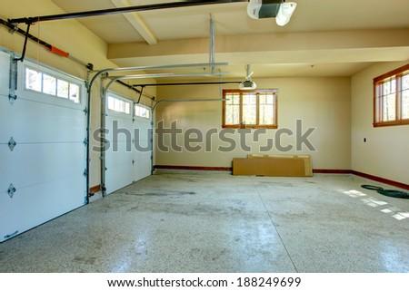 Empty garage with roller door. View of horizontal tracks. - stock photo