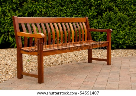 Empty garden seat in spring - stock photo