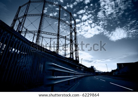 Empty gasometer and street - stock photo